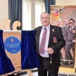 Raymond Hazan OBE unveils plaque to mark the Blind Veterans Foundation's 100 years in service.
