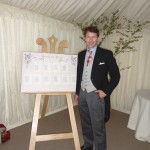 Singer James Blunt at private wedding. Display easel holds the seating plan.