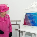 The queen unveils plaque with unveiling drape at Birmingham dental hospital
