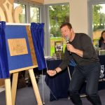 Dermot O'Leary unveils plaque to commemorate the opening of the new Arts Centre at Hoe Bridge School