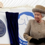 The Queen uveils plaque at Battersea Dogs Home to open new state-of-the-art Mary Tealby Kennels.
