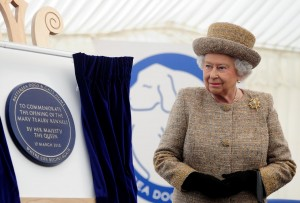 Plaque unveiling by Her Majesty The Queen at Battersea Dogs Home using our plaque unveiling solution - display easel and plaque unveiling curtains.