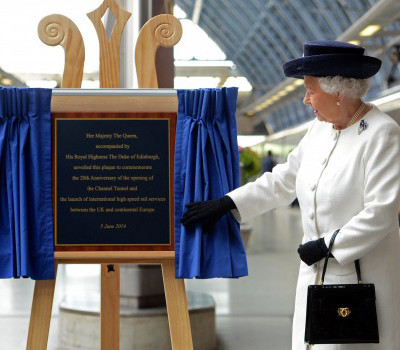 Her Majesty The Queen unveils plaque to celebrate 20th anniversary of Channel Tunnel opening and launch. Plaque unveiled using our plaque unveiling stand curtains and plaque unveiling easel stand.